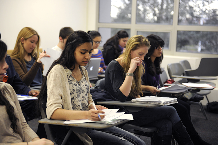 Adelphi students in classroom focused on assignment